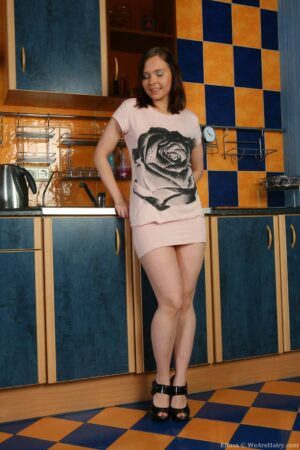 Peak up Effasa's Dress in the Kitchen