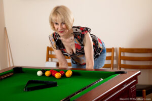 Congenital Hazel leans over the Pool Table