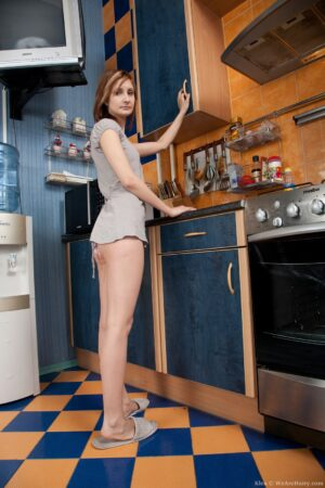 Klea stretches her Cheeks in the Kitchen