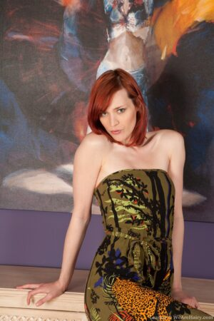 Redhead Leanne stretches her unshaven Bush