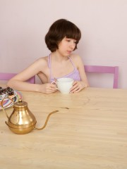 Miki Sips her Tea and opens up her gams