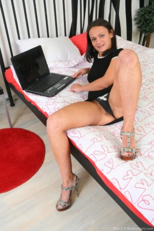 Mila Z observes Porn on her Laptop