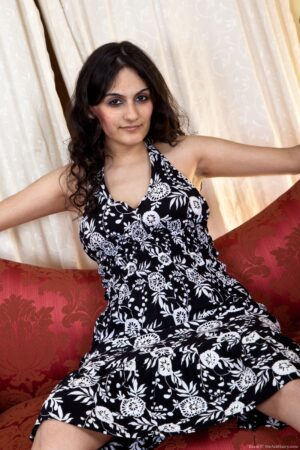 Riani Gets Risky on a Red Couch