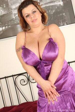 Vanda bursts out of her velvety Dress