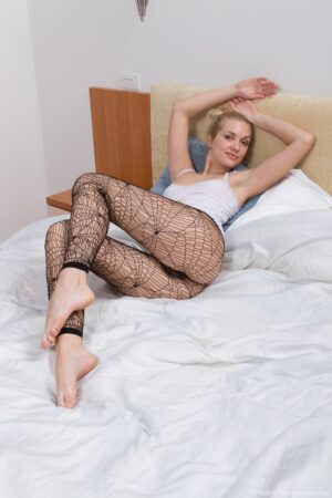 Bushy doll Felicia in ebony Fishnet pantyhose