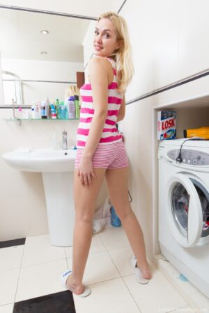 Unshaven lady Felicia gets bored washing her clothes