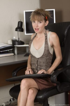 In her office Rosy Heart strips naked for us