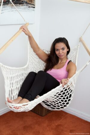 Natural girl Lucie lounges in her hammock