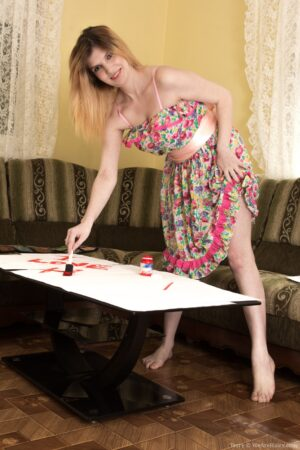 Terry paints and then undresses to show body