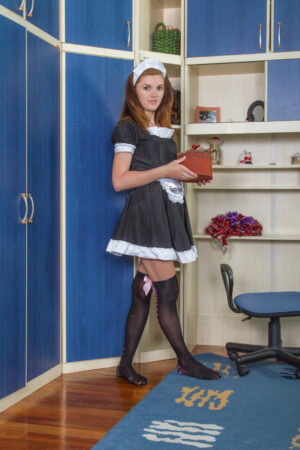 The french maid Milana S strips naked for fun